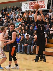 Ridgewood's Zach Wright shoots a 3 against Garaway