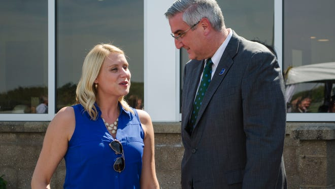 Lt. Gov. Eric Holcomb shakes hands with Valerie Shaffer of the Economic Development Corporation of Wayne County following the ribbon-cutting ceremony for the SugarCreek food processing facility in Cambridge City, Indiana on Thursday, Sept. 22, 2016.