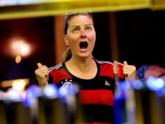 Germany soccer fan Kristine Seinsch reacts after Germany