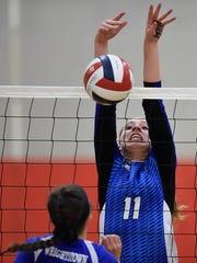 Green Bay Notre Dame's Corinne Meglic (11) blocks a