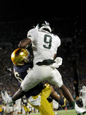 MSU freshman receiver Donnie Corley (9) fights for the ball in the air with Notre Dame's Cole Luke in the end zone in the first half Saturday night. Corley won the mid-air wrestling match for a 38-yard touchdown.