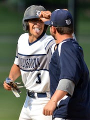 Dallastown's Bryant Hotzapple reacts after connecting
