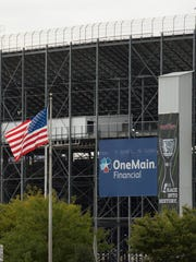 View of an American flag outside the race track at Dover International Speedway in Dover.