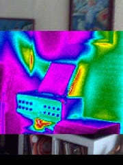 An infrared scan of a Burlington apartment shows heat emanating (in yellow and red)  from idle electronic gear.