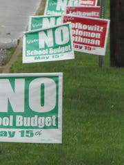 Signs in the East Ramapo district in 2012 encourage