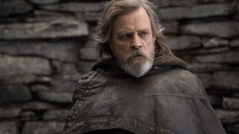"""This image released by Lucasfilm shows Mark Hamill as Luke Skywalker in """"Star Wars: The Last Jedi,"""" in theaters Dec. 15."""