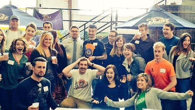 Wausau's young professionals group tours a brewery during last year's YP Week.