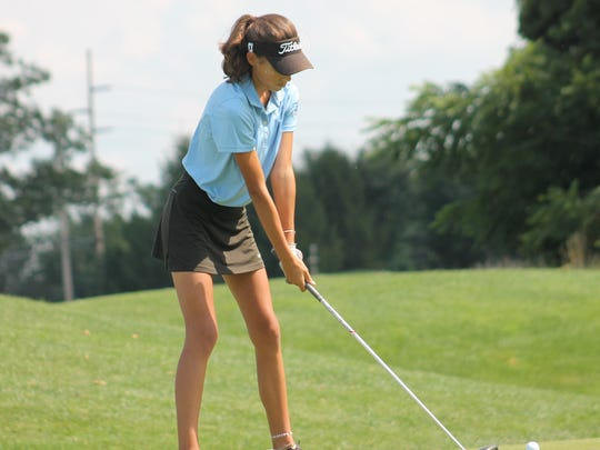 Freshman Leah Swayne prepares to tee off for Kings on the first hole at TPC River's Bend.