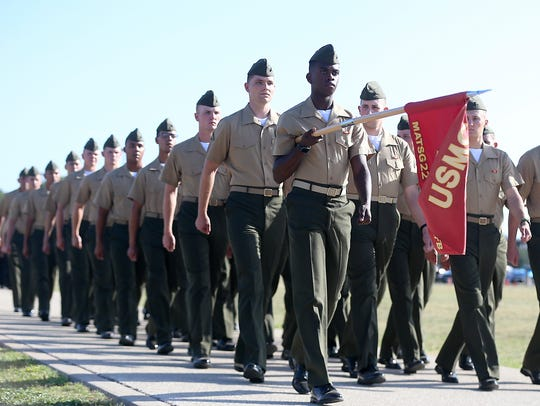 Marines march for inspection before Col. Ricky Mills,