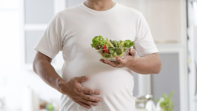 One way to eliminate belly fat is to change your diet. Eat plenty of vegetables and cut down on fatty foods.