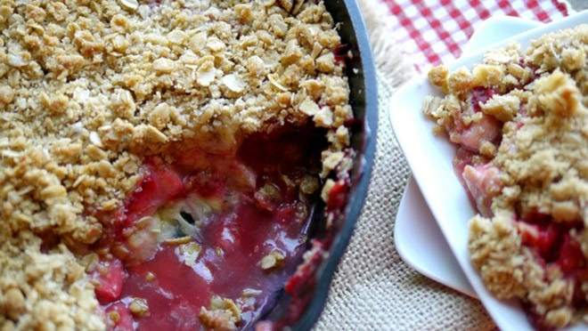 An easy crumble features strawberries and banana with a topping of oats.