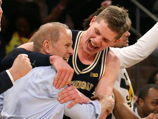 Michigan forward Moritz Wagner hugs coach John Beilein