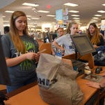 Jacee Palmer from Bogue Chitto buys clothes for the upcoming school year at Kohl's during the tax-free weekend.