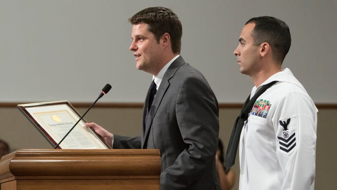 Congressman Matt Gaetz recognizes Navy Petty Officer First Class Joseph Pellicano for his heroic actions during the Escambia County Commission meeting on Monday, June 19, 2017.  Pellicano helped save the life of Kaysin Willis who was involved in a car accident on Jan. 16, 2017.