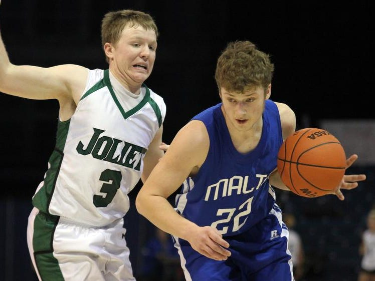 Jeremy Costin of Malta drives around Joliet defender Levi Mydland during State B action Thursday afternoon in Bozeman.