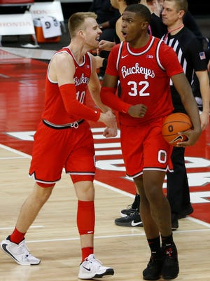 Ohio State's E.J. Liddell, right, celebrates against Penn State with teammate Justin Ahrens during the second half of an NCAA college basketball game Wednesday, Jan. 27, 2021, in Columbus, Ohio. Ohio State beat Penn State 83-79. (AP Photo/Jay LaPrete)