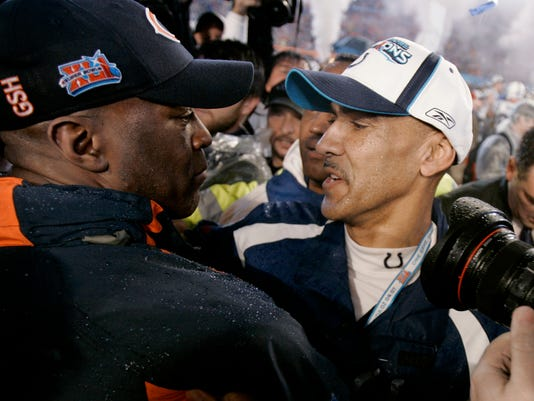 FILE - In this Feb. 4, 2007, file photo, Indianapolis Colts coach Tony Dungy, right, hugs Chicago Bears coach Lovie Smith at the end of NFL football's Super Bowl XLI in Miami. The Colts defeated the Bears 29-17. (AP Photo/David Duprey)