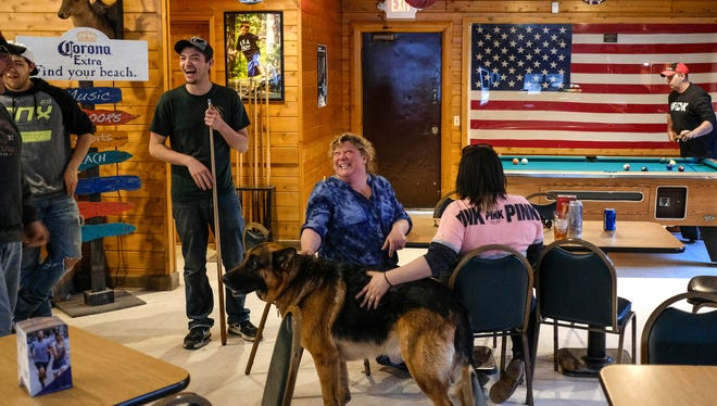 (left to right) Ray Orsborne, Dylan Orsborne, Billie Orsborne and Tiffany Landreville, all of Hessel, laugh while playing pool with Cub McCord of Pickford at the Runway Bar in Hessel on Friday, April 27, 2018 in Michigan's Upper Peninsula.