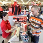 Pamela Ramos assists John Conner with a purchase at a Family Dollar store in Waco.