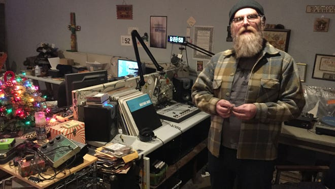 Steven Cherry built a low-power AM station that he runs from the front room of his corner home on Sobieski Street in Hamtramck. He is photographed in December 2015.