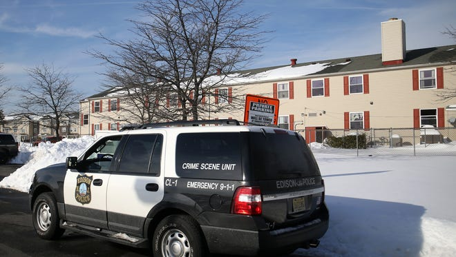An Edison police vehicle is parked in front of the Ozanam Shelter following a carbon monoxide emergency, Monday, Jan. 25, 2016, in Edison.
