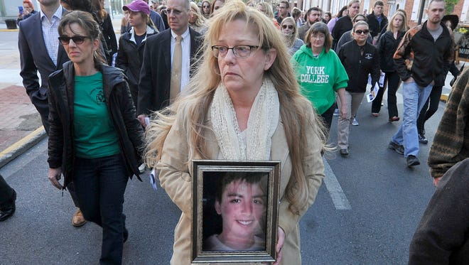 'He was murdered trying to help a friend.' said Sue Aldinger of her son, Braydon, who was shot and killed on Nov. 23, 2014. Aldinger joined others during the 30th annual Crime Victim' Rights March and Candlelight Vigil.
