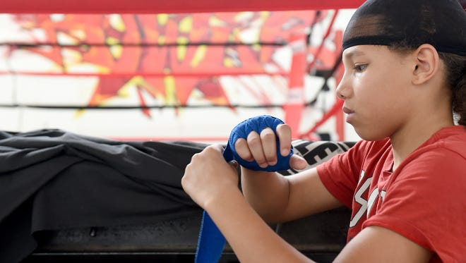 Antwoine Dorm Jr. wraps his hands before training at Stick-N-Move Boxing in York. Antwoine, 11, is headed to Missouri to compete in the Silver Gloves National Boxing Championship from Feb. 1 through Feb. 4.