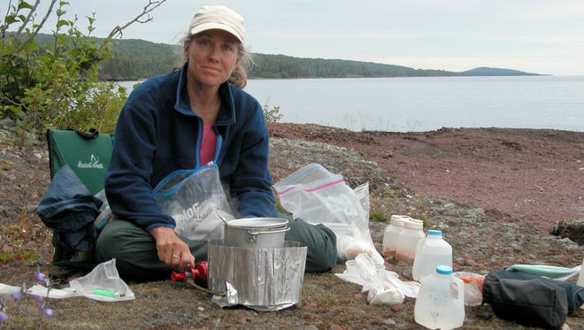 Leah Vucetich, an assistant research professor, helps collect scat, urine and other specimens from Isle Royale moose and wolves.