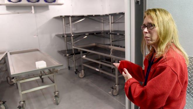Pat Felix, the Adams County Coroner, talks about the morgue cooler on Thursday, Dec. 29, 2016.