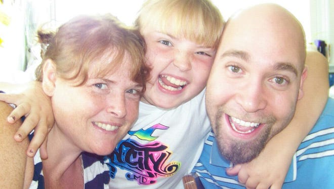 Jason Taylor, 37, right, is shown with his fiance, Pam Bowie, and her daughter Aubrey, who is now 16 years old, in this photo from several years ago. Taylor died Wednesday at York Hospital from injuries he suffered last month when he was struck by a vehicle while trying to help a neighbor free a lawn mower stuck on a raised curb.