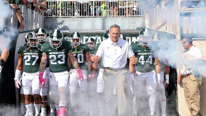 Michigan State Spartans head coach Mark Dantonio leads his team onto the field prior to a game against the Indiana Hoosiers  at Spartan Stadium. Mike Carter-USA TODAY Sports