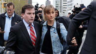 Allison Mack leaves Federal court Tuesday, April 24, 2018, in the Brooklyn borough of New York. Mack, an actress best known for playing a young Superman's friend, has been granted bail while fighting charges that she helped recruit women into a cult-like group.
