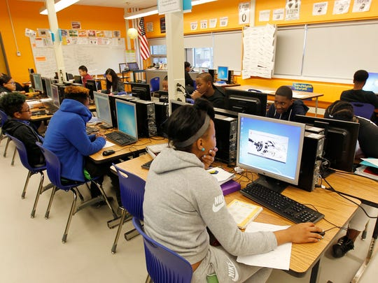 Students work in the new, brighter computer technology classroom at Rufus King International Middle School.