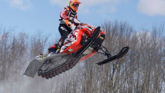 A snowmobile driver launches off a jump during the Budweiser Classic Race of Champions last January near Plymouth.