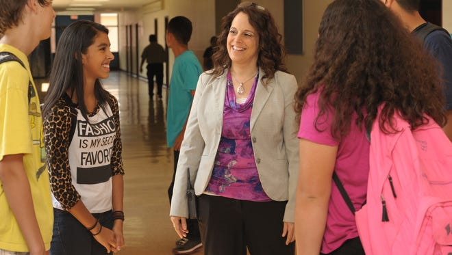 08/31/2015: Assistant principal Toni Hull, center, meets with eighth graders in the hallway at Picacho Middle School in Las Cruces.