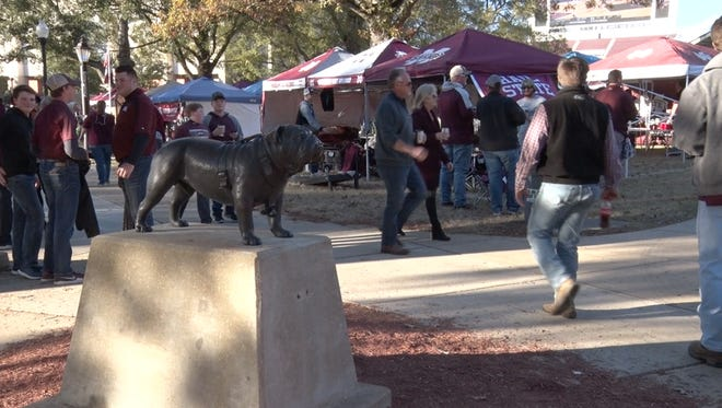 Fans mill around outside Davis Wade Stadium before the Egg Bowl on Thanksgiving.