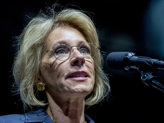 President-elect Donald Trump's pick for education secretary, Betsy DeVos, speaks during a rally at DeltaPlex Arena, Friday, Dec. 9, 2016, in Grand Rapids, Mich.