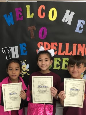 "Capt. H.B. Price Elementary School held its annual spelling bee on Jan.19 and 31 students went 16 rounds to determine the winner. The winning word was ""defensiveness"". Pictured front row from left: Temi Willy 4th grade 3rd place; Taelor Mafnas 4th grade 2nd place; and Robert O'Brien 4th grade 1st place. Robert will represent Capt. H.B. Price Elementary School in the regional spelling bee on March 3."