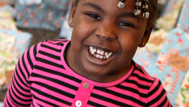 Diane Wingfield, 4, smiles for the camera during the annual Gift-Giving Party at Nyack Center, Dec. 20, 2012 in Nyack. The after-school program, with most of the children at or below the Federal income guidelines for poverty, is made possible with a $10,000 grant from First Niagara Foundation.