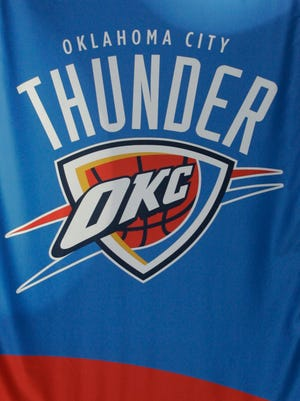A banner with the name, logo and colors of the Oklahoma City Thunder.