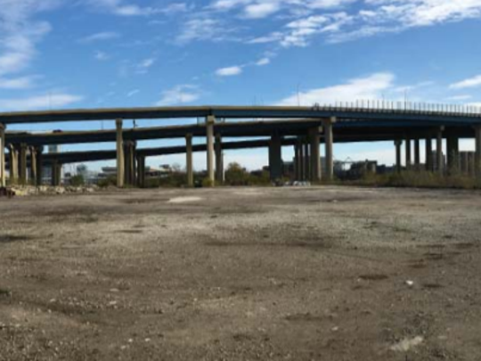 A15-acre site between W. Mount Vernon Ave. and the Menomonee River, with I-43 crossing above it.