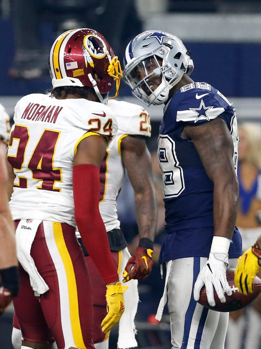 FILE - In this Thursday, Nov. 24, 2016 file photo, Washington Redskins cornerback Josh Norman (24) and Dallas Cowboys wide receiver Dez Bryant (88) scuffle after Bryant caught a pass in the second half of an NFL football game in Arlington, Texas. The Dallas Cowboys' top receiver and Washington Redskins' top cornerback developed quite the heated rivalry on and off the field over the past year, stemming from a physical meeting last Thanksgiving. The Dallas Cowboys play the Washington Redskins on Sunday, Oct. 29, 2017. (AP Photo/Michael Ainsworth, File)