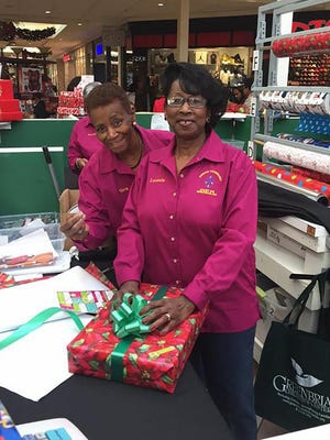Volunteers help wrap gifts at the Oglethorpe Mall. This year's Holiday Gift Wrap Center will run from Dec. 3-24. The fundraiser helps the nonprofit Greenbriar Children's Center.