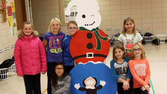 Students at JFK Elementary pose with a snowman who will be displayed in downtown Sioux Falls.