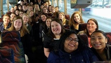 Plymouth-Canton's Festival Singers on the bus to district choral festival.
