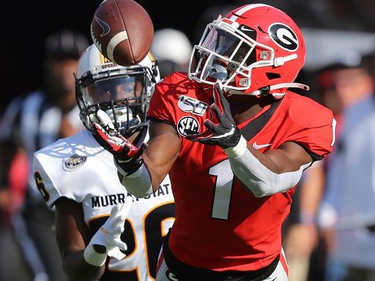 Georgia wide receiver George Pickens catches a long pass past Murray State defensive back Cortez Roberts on Saturday, Sept. 7, 2019, in Athens, Ga.