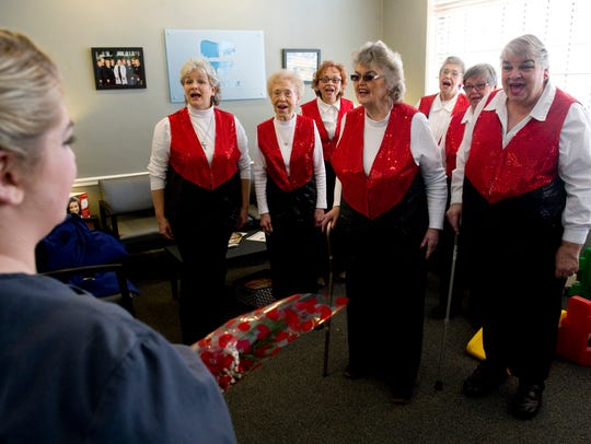 The Sweet Adelines serenade Karlinda Schwambach with