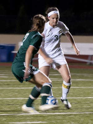 St. Norbert College forward Katie Vanden Avond (3) tries to advance the ball past Wisconsin Lutheran's Sarah Kolander in the first half of a nonconference women's soccer game at Donald J. Schneider Stadium in De Pere.