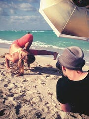 "Rachel Brathen poses for a photo shoot. Brathen said beach yoga is her favorite because it's so ""freeing."""
