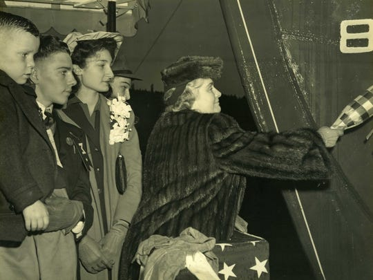 Six-year-old Billy Michal (foreground) looks on as Mrs. Gerhauser, wife of the Delta Shipping Co. president, christens the Liberty ship.